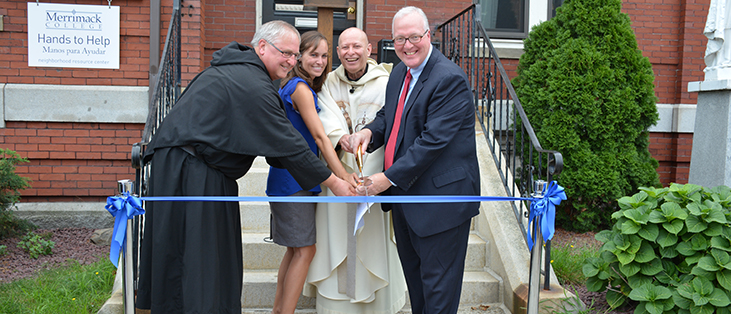 Fr. Raymond Dlugos, OSA, Vice President Mission and Student Affairs with Alisha Repucci, Director, Community Outreach and Fr. Carlos Urbina, OSA, pastor of St. Mary of the Assumption and President Christopher E. Hopey, Ph.d. as they cut the ribbon at the grand opening of the Hands to Help neighborhood resource center at St. Mary's Parish in Lawrence, Mass.